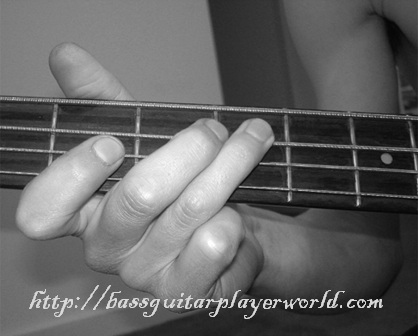 holding the bass by the fretboard