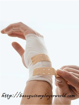 injury to the fretting and picking hand