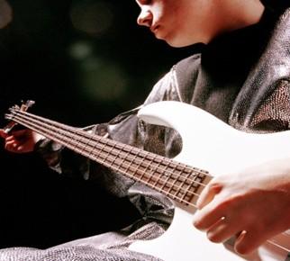 performing bass guitar